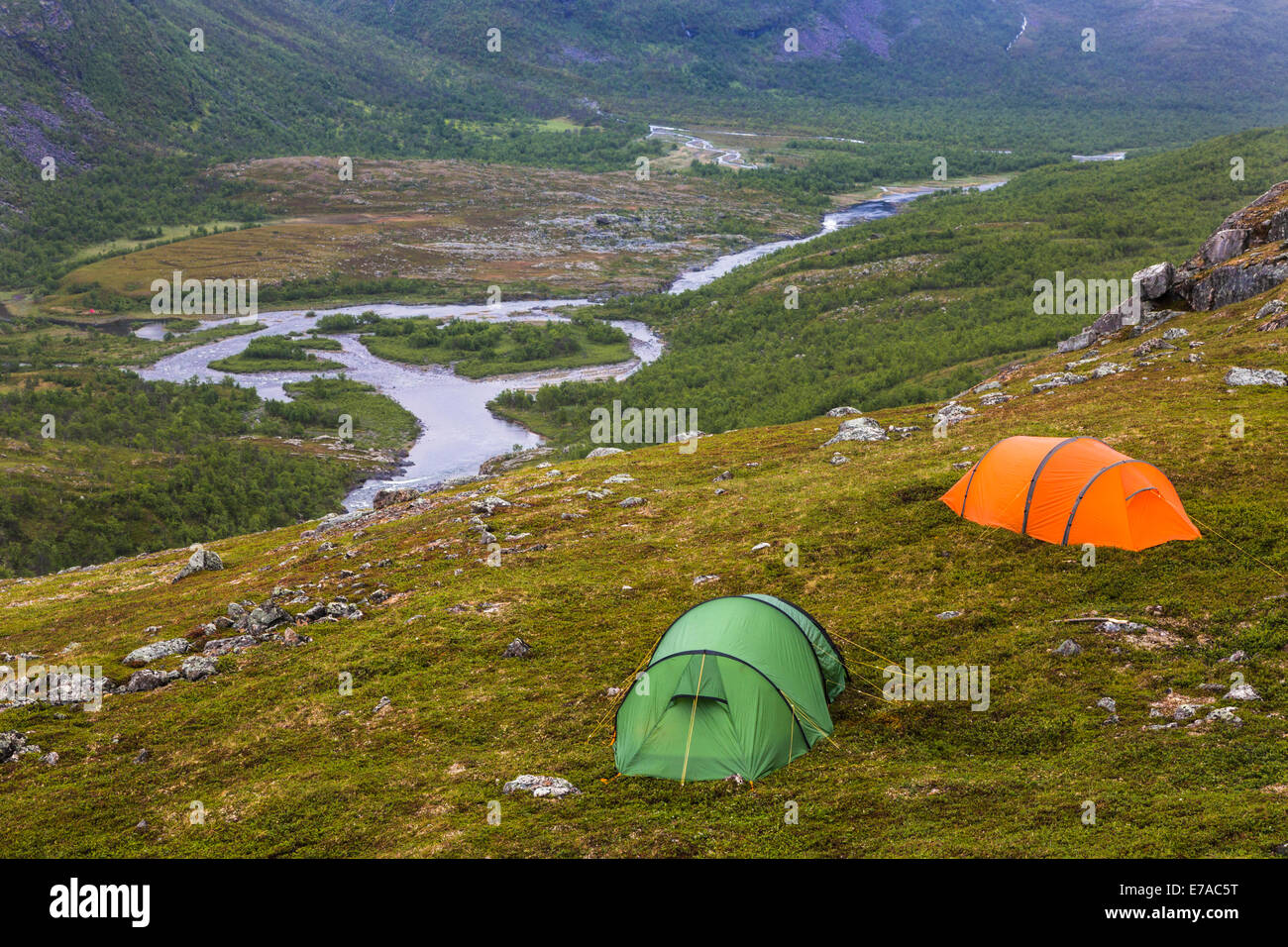 Tents on high altitude with river flowing underneath in stora sjöfallets national park, Gällivare, Swedish - Stock Image