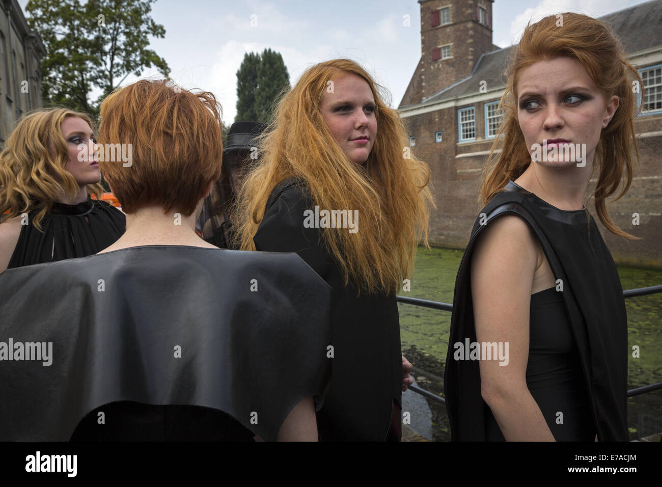 A group of models waiting to participate in one of the fashion shows held during the festival of redheads - Stock Image