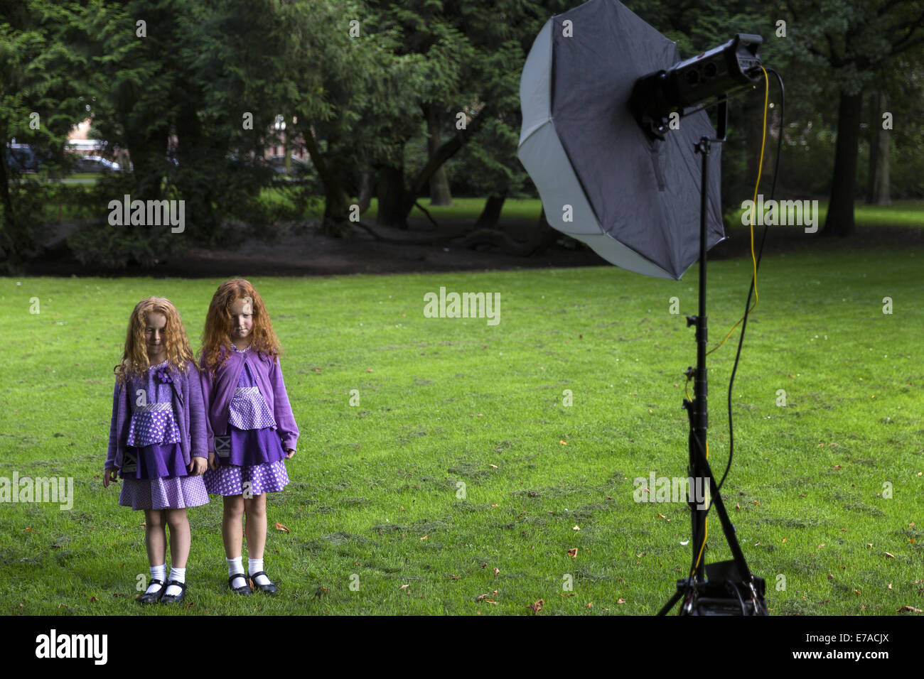 Two redheads girls pose for a portrait in the park of Breda during the festival of redheads. - Stock Image