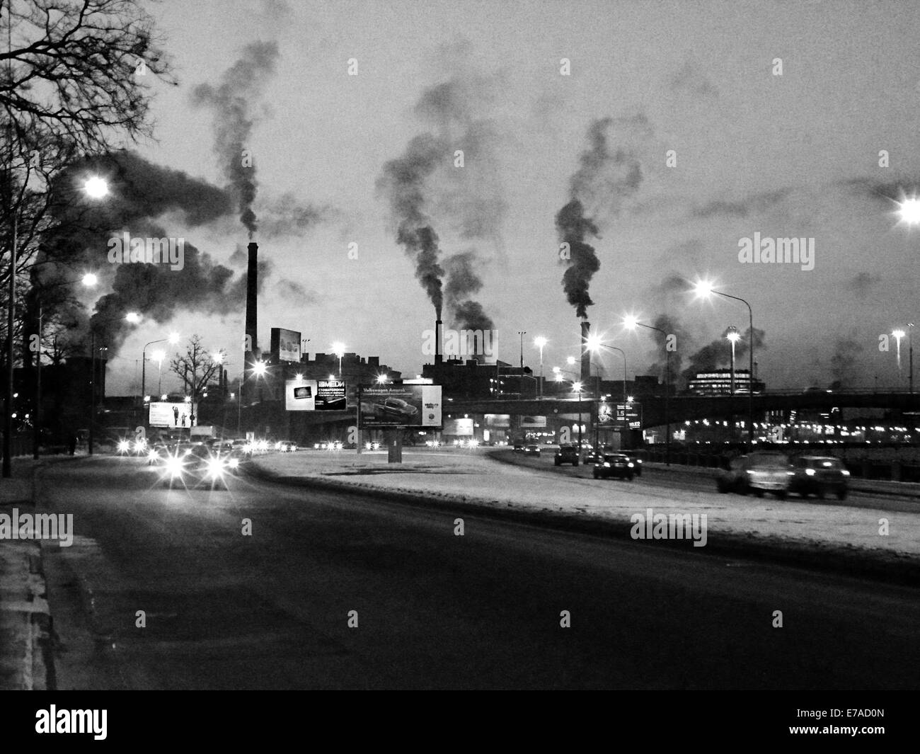 Smoke is coming from the chimneys. Cars - Stock Image