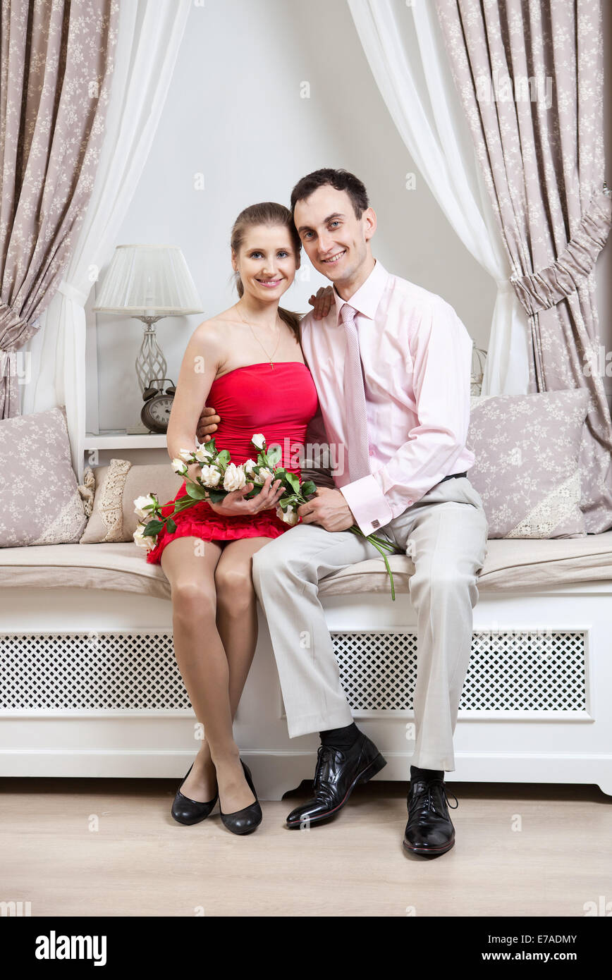 Happy young couple posing in luxury interior - Stock Image