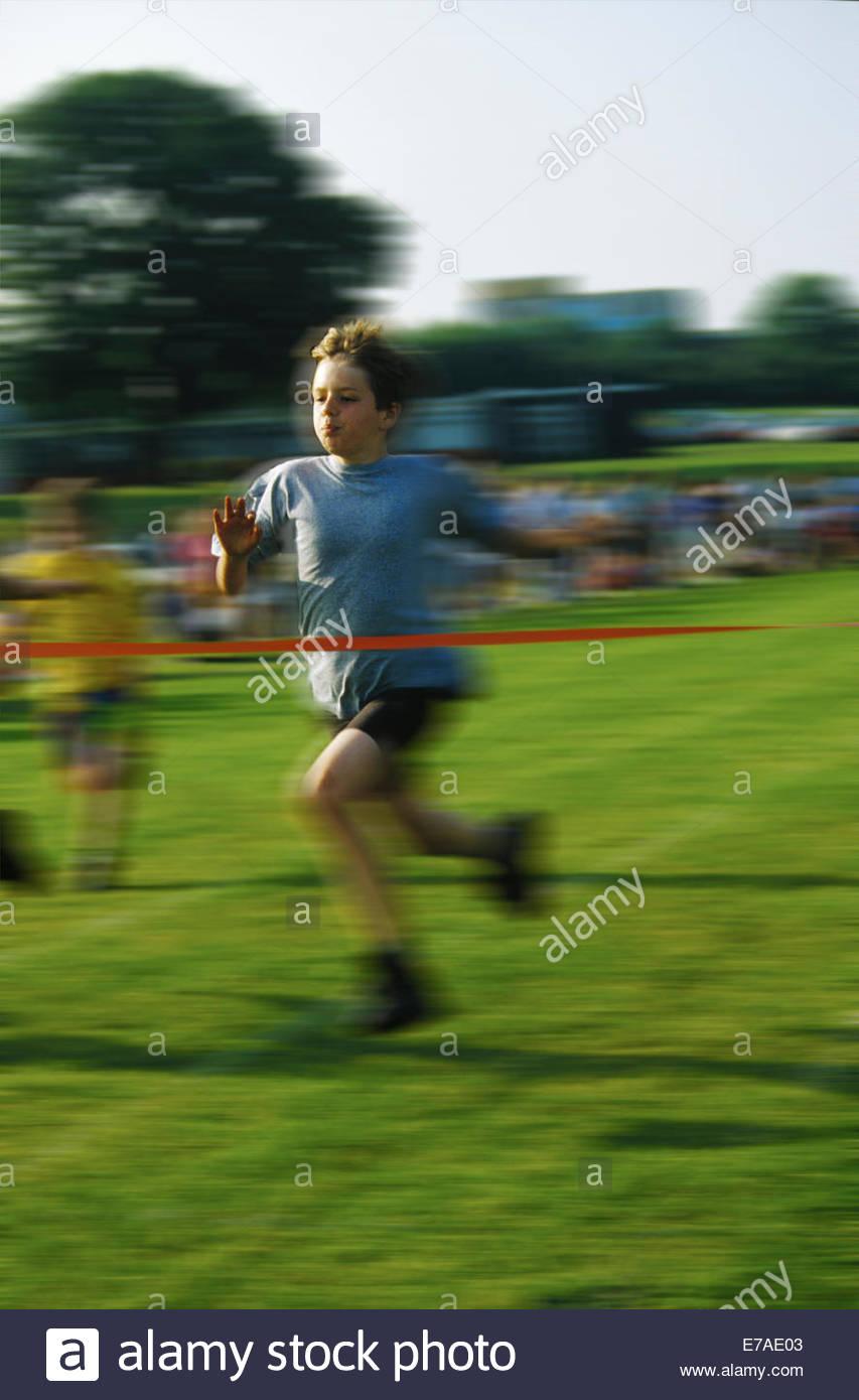 boy-winning-schoole-sports-race-finishin