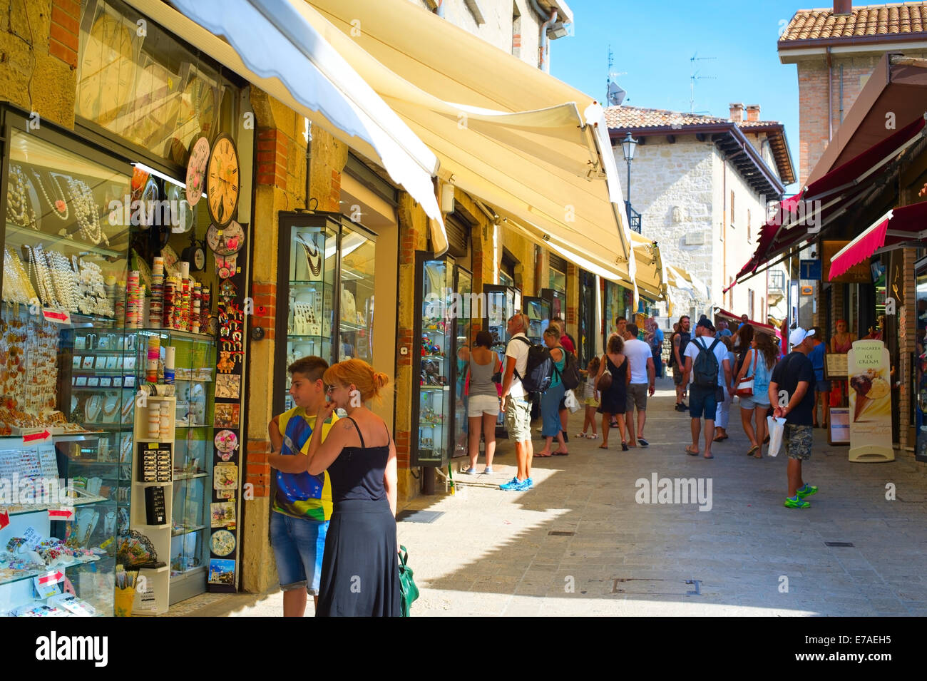 Tourists at the street of Old Town of San Marino. Tourism in San Marino contributes approximately - Stock Image