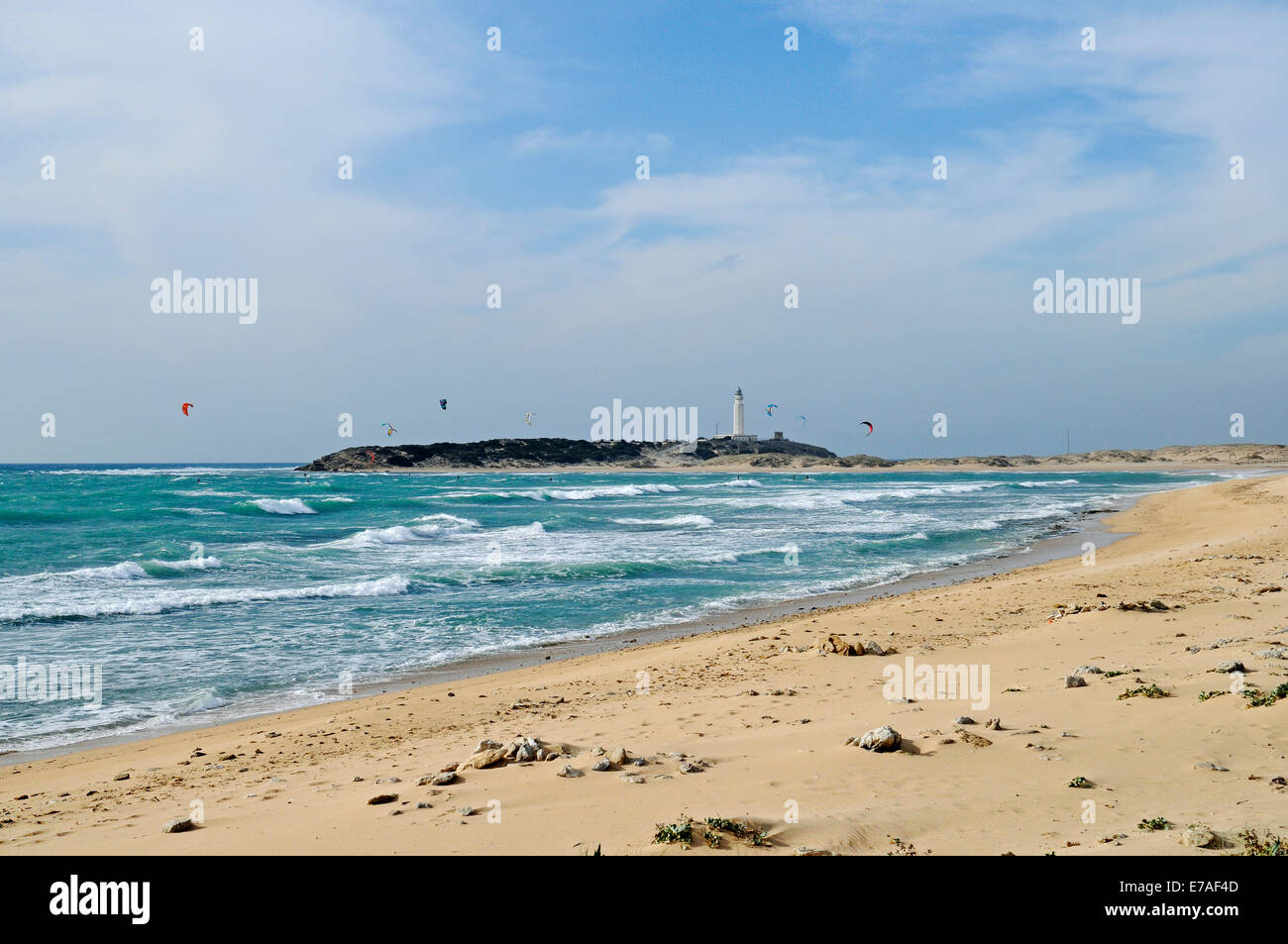 Playa de Caños de Meca, beach, kitesurfers, Cabo de Trafalgar at the back, lighthouse, Barbate, Cadiz province, - Stock Image