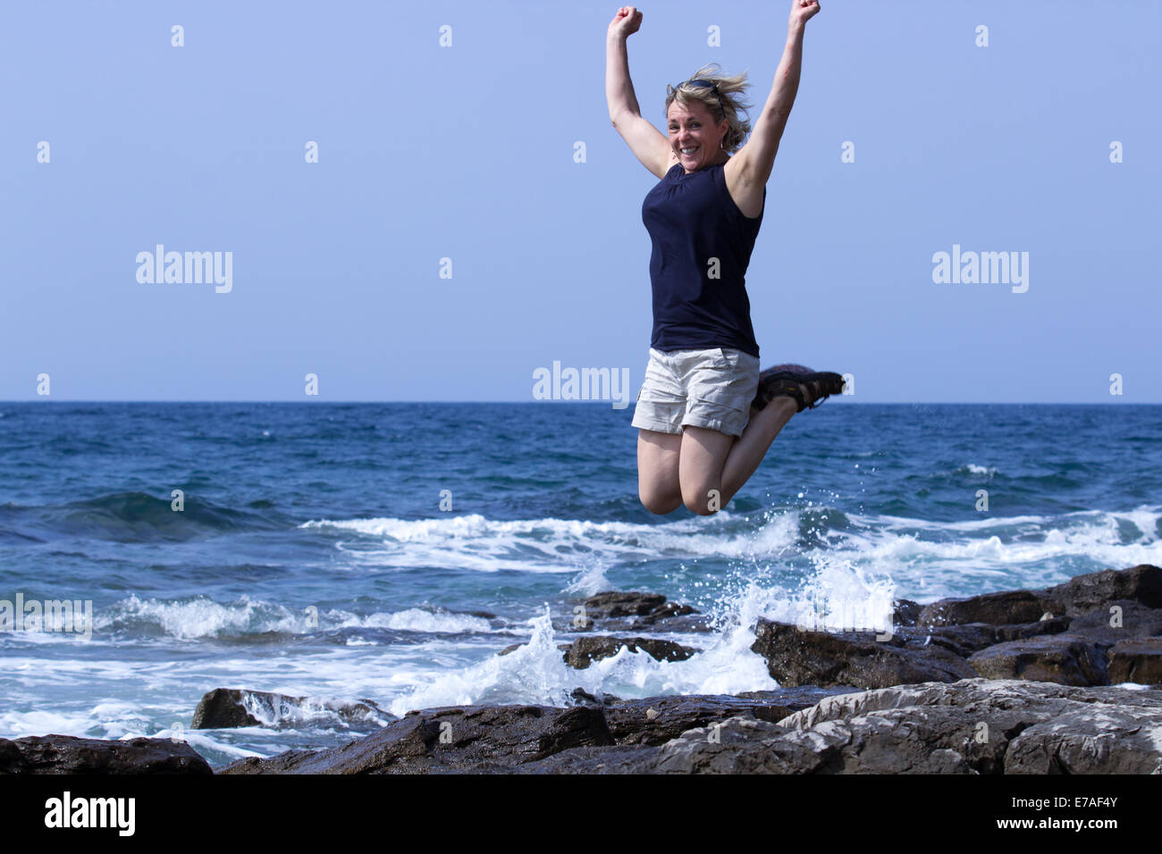 middle aged lady jumping for joy Stock Photo