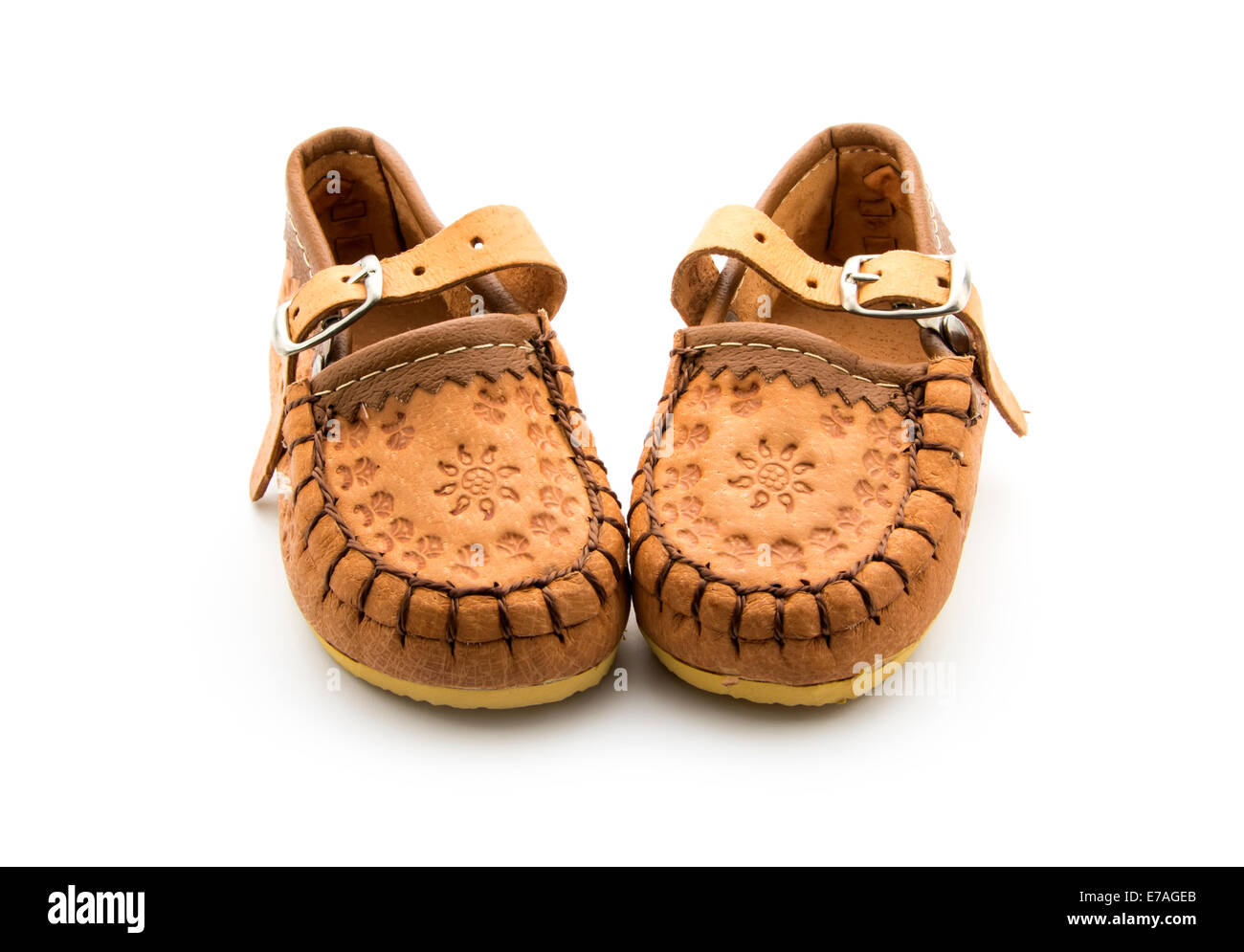 d1fcb798aecb hand made traditional shoes for little girl isolated on white - Stock Image