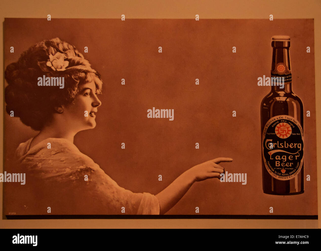 Old sepia poster promotes Carlsberg Lager beer. - Stock Image