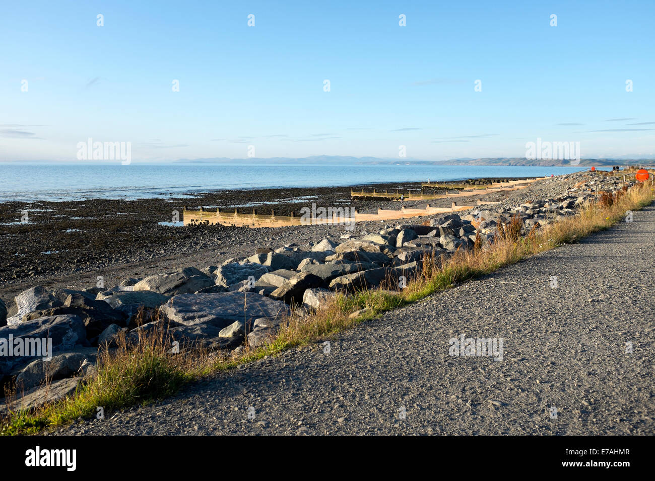 Rocky Stony Beach Coastal Path Summer Blue Sky - Stock Image