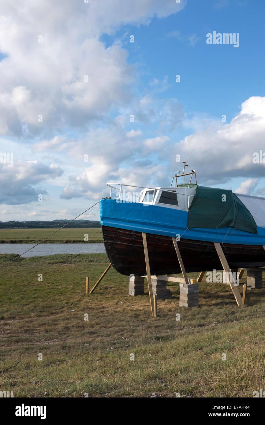 Boat Repair Stilts Out Of Water Paint Refurbish - Stock Image