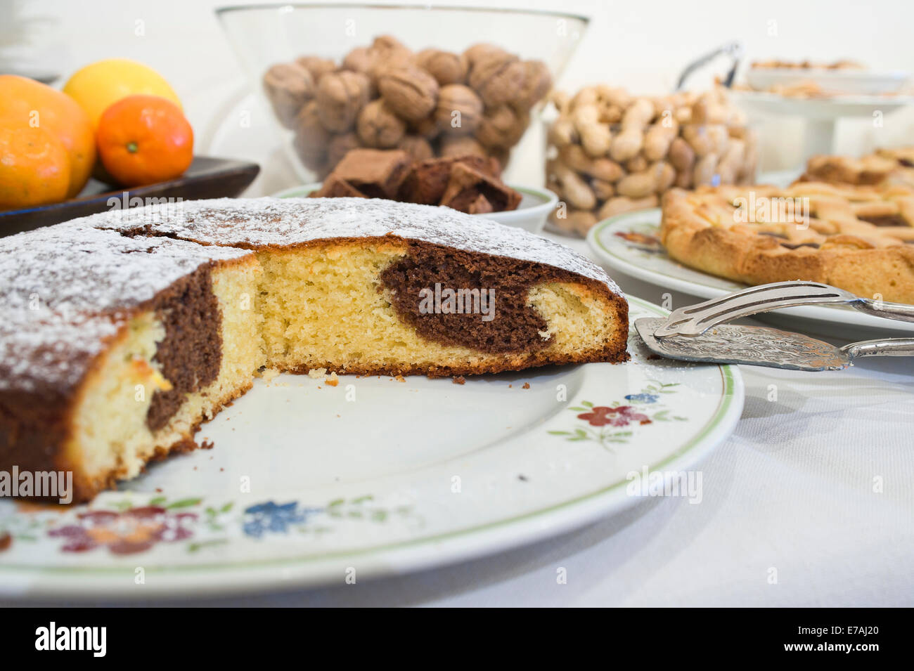 table set for breakfast with chocolate cake closeup - Stock Image