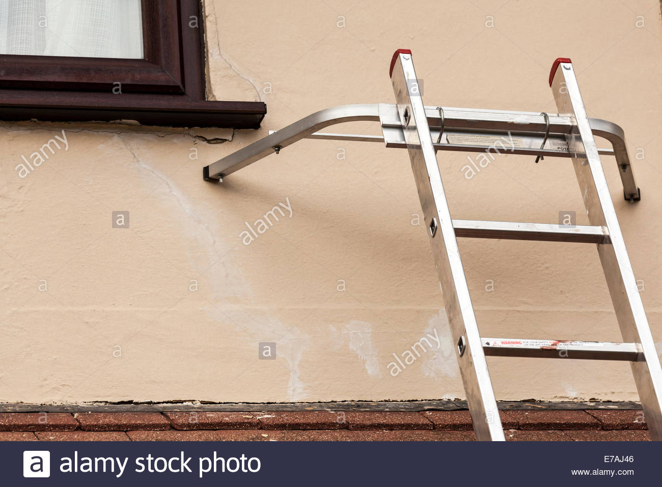 Ladder with standoff - Stock Image