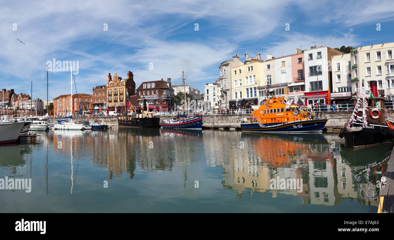 Panorama of Ramsgate Harbour showing the RNLI Esme Anderson and several other historic boats. - Stock Image