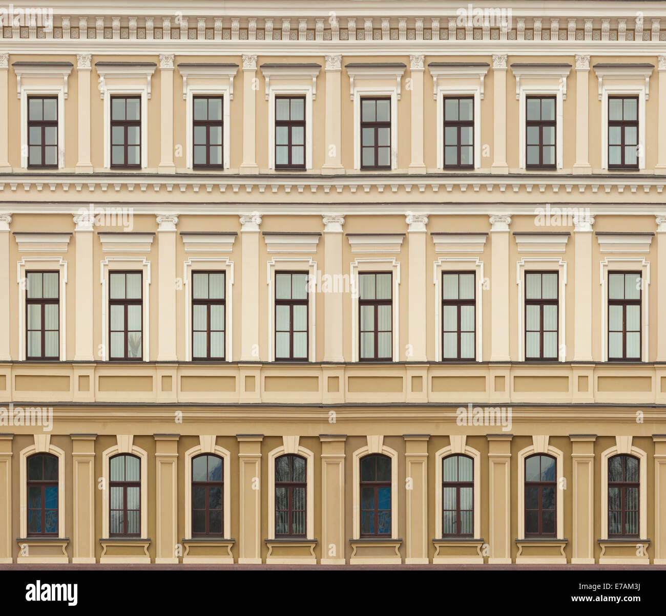 Neoclassic architecture wall with windows vintage building background - Stock Image