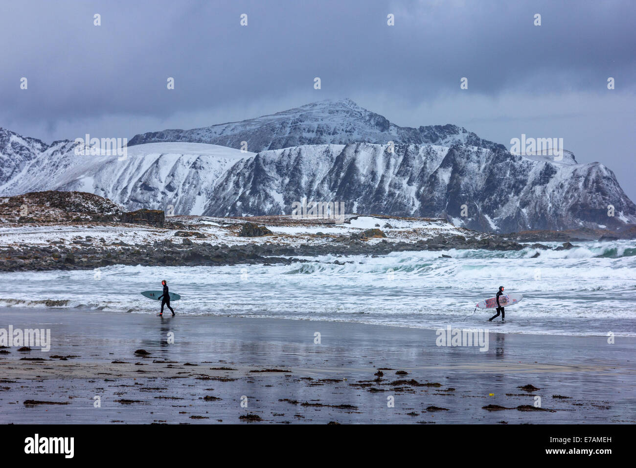 Winter surfers at the Lofoten islands Stock Photo