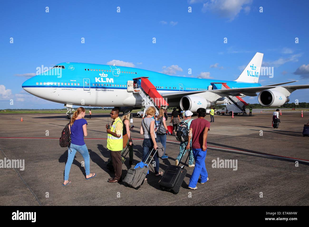 Passengers walking to a KLM Boeing 747 on the apron at Johan Pengel International Airport, Zanderij, Paramaribo, - Stock Image