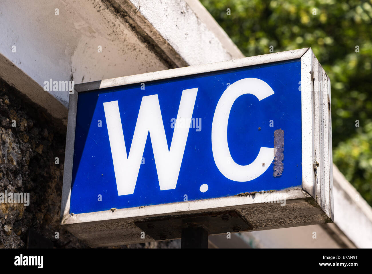 A blue W.C. sign shows the entrance to a water closet. - Stock Image