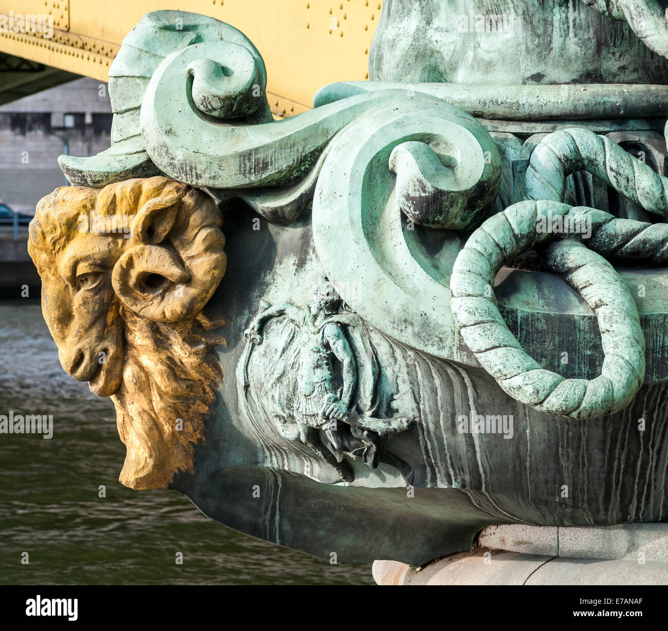 A close up of the golden ram head sculpture on Pont Mirabeau which crossing the Seine River in Paris France. - Stock Image