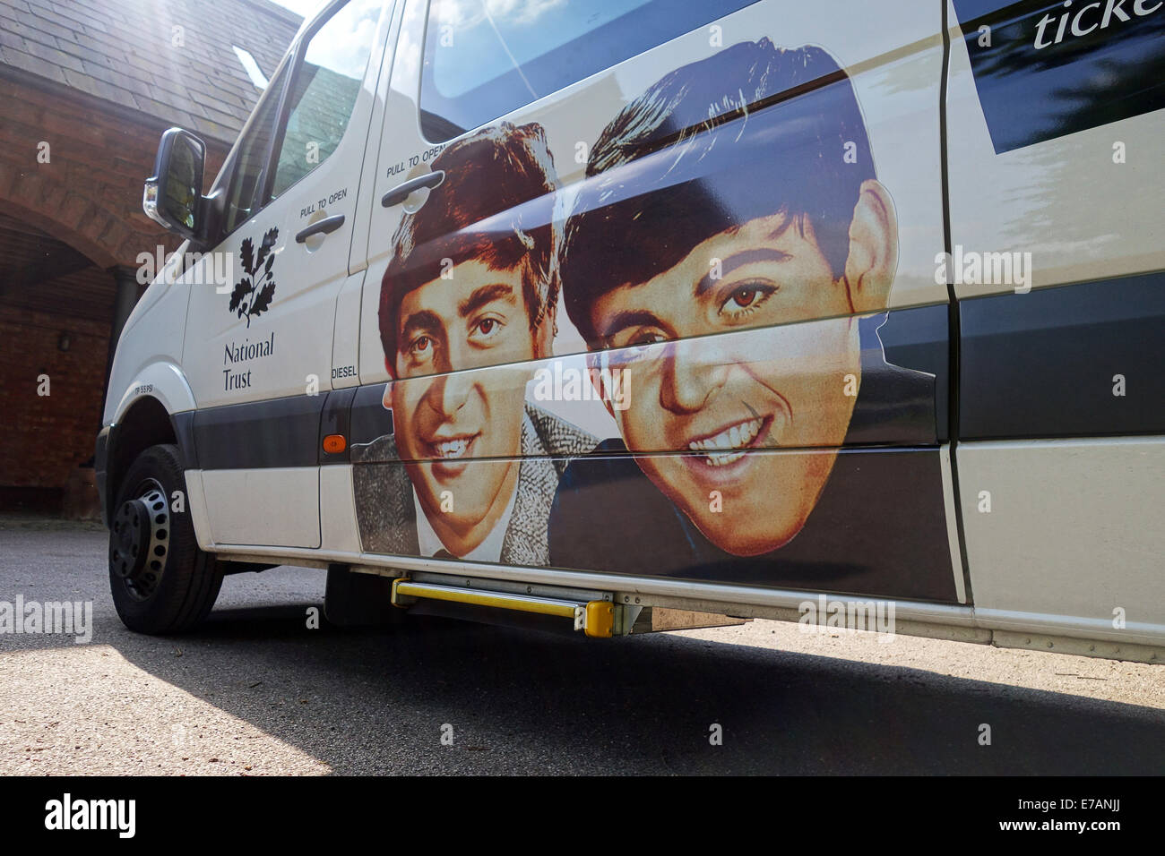 National Trust minibus with portraits of The Beatles John Lennon & Paul McCartney for taking visitors to their - Stock Image