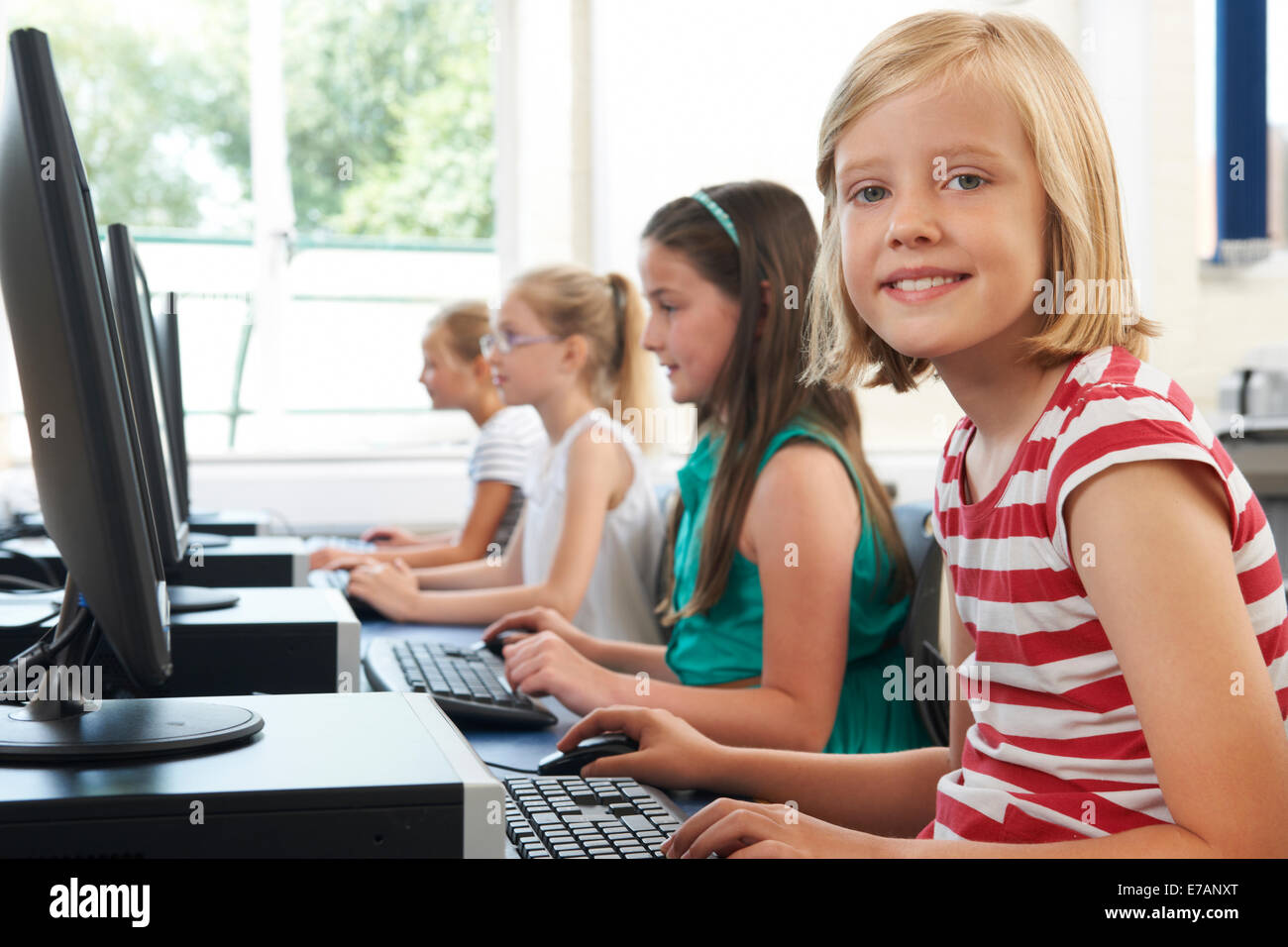 Group Of Female Elementary School Children In Computer Class - Stock Image