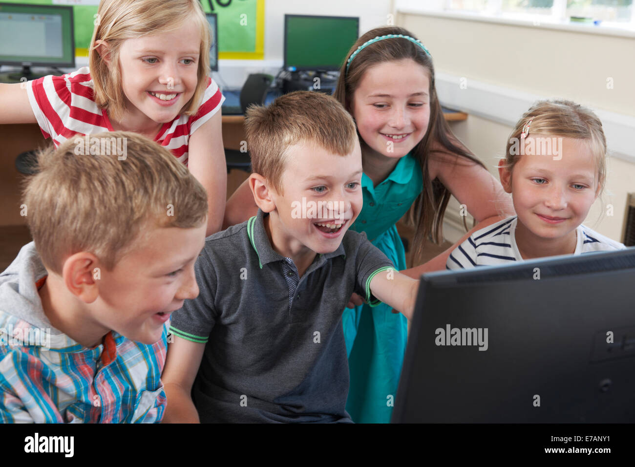 Group Of Elementary Pupils In Computer Class - Stock Image