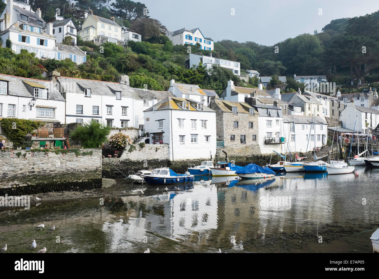 Fishermen's houses and boats in the historic fishing village of Polperro, Cornwall Stock Photo