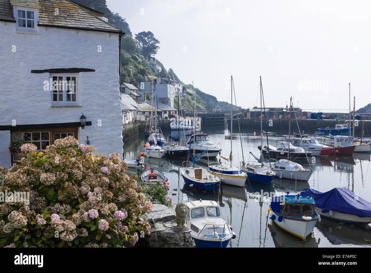 Fishermen's houses and fishing boats in the historic fishing village of Polperro, Cornwall Stock Photo