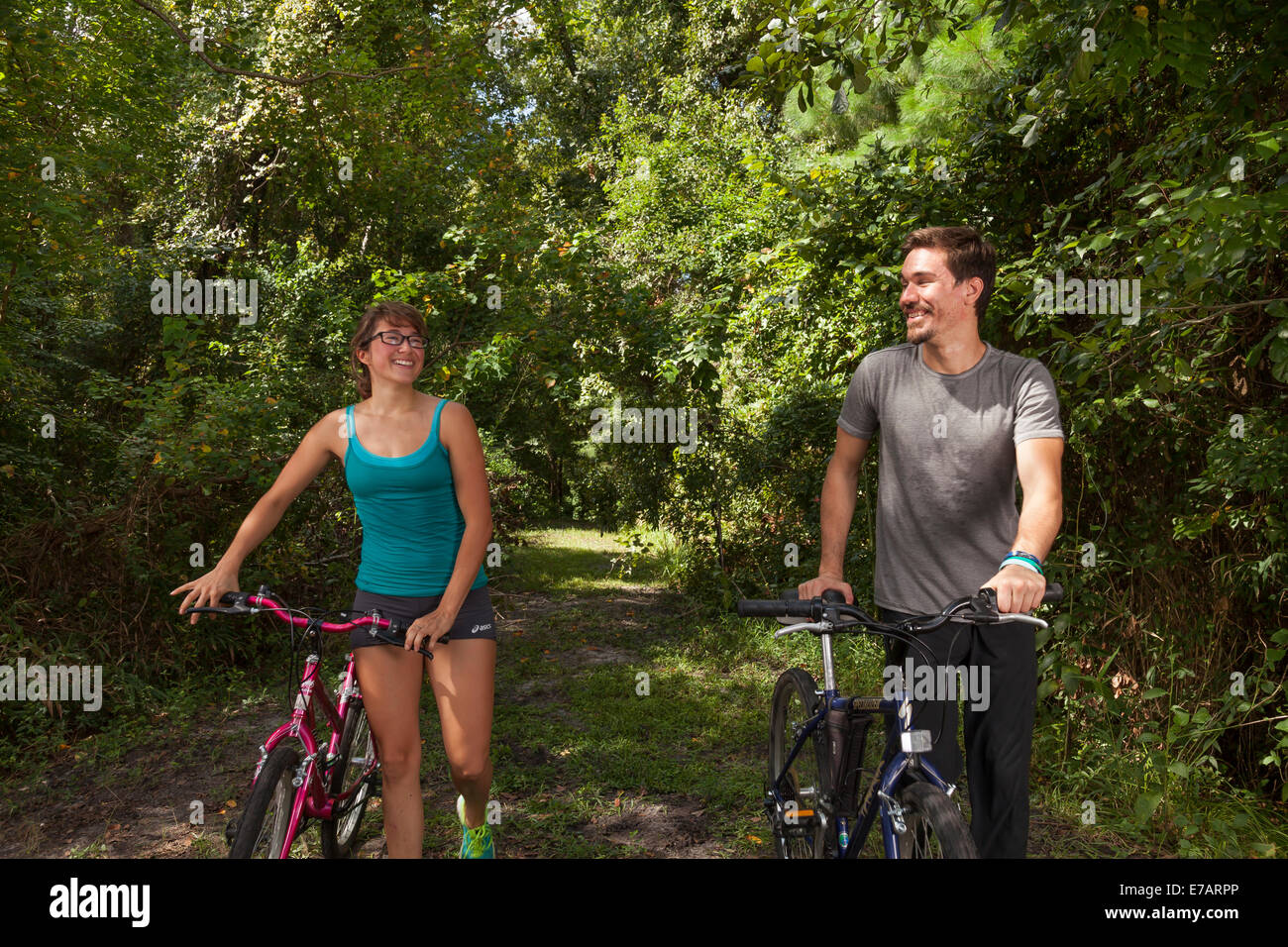 A view of a couple returning from a bicycle ride near Jacksonville, FL. - Stock Image