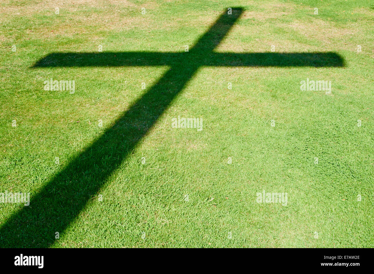 Shadow Of A Cross On Grass Lawn At The German Military Cemetery Cannock Staffordshire UK - Stock Image