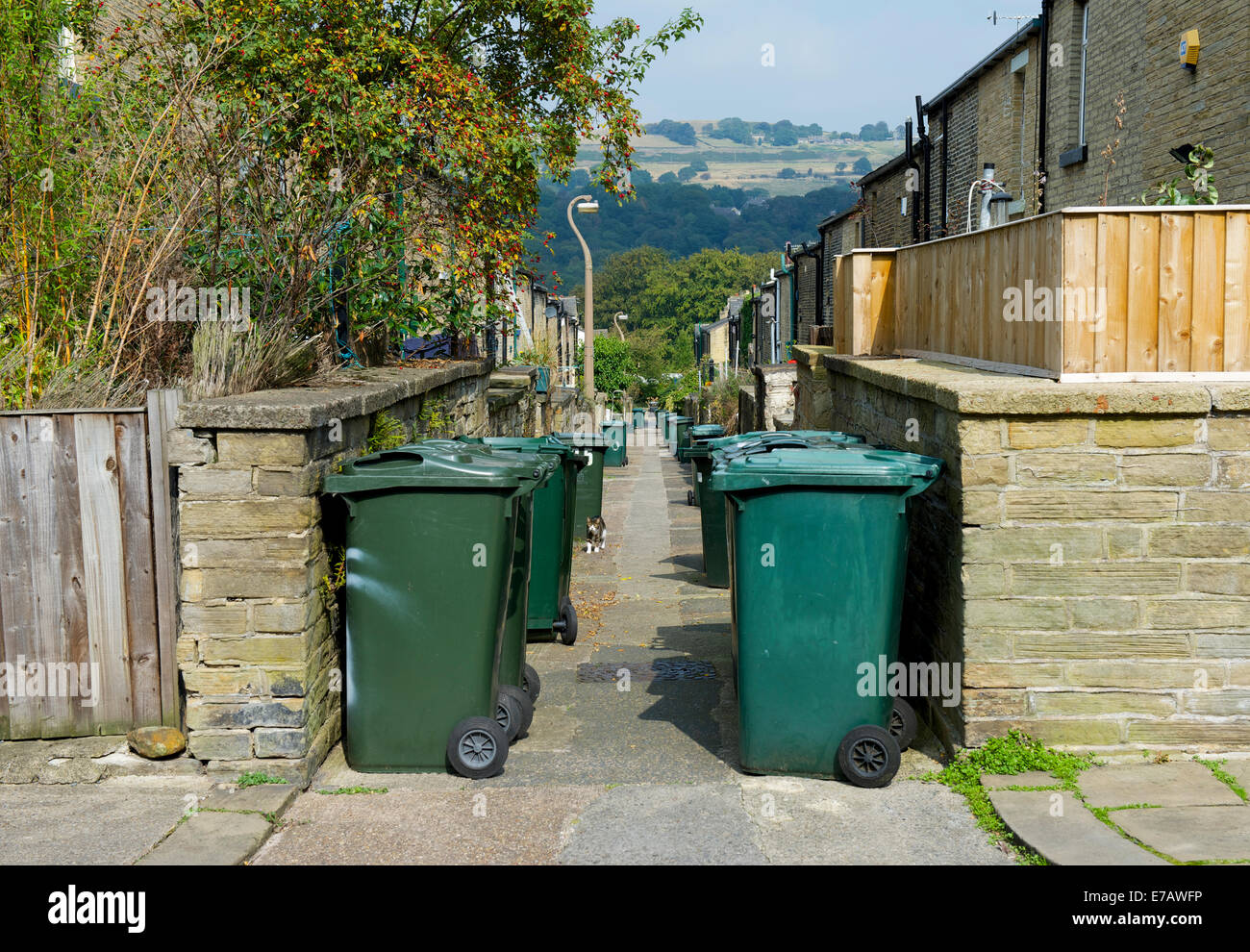 Rubbish bins in backstreet, Saltaire, West Yorkshire, England UK - Stock Image