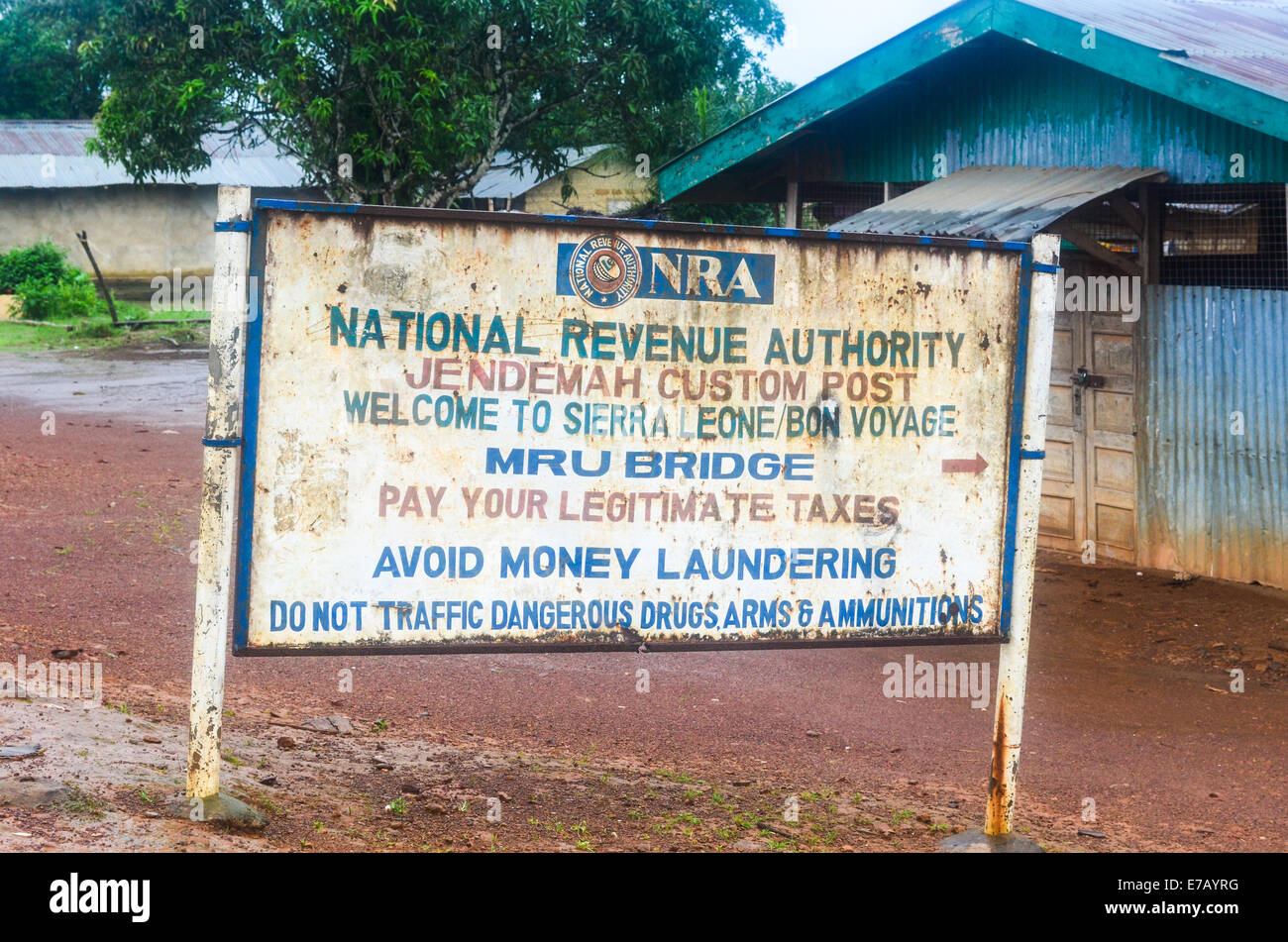 Jendemah border post between Sierra Leone and Liberia, Africa, with a sign board of the customs - Stock Image