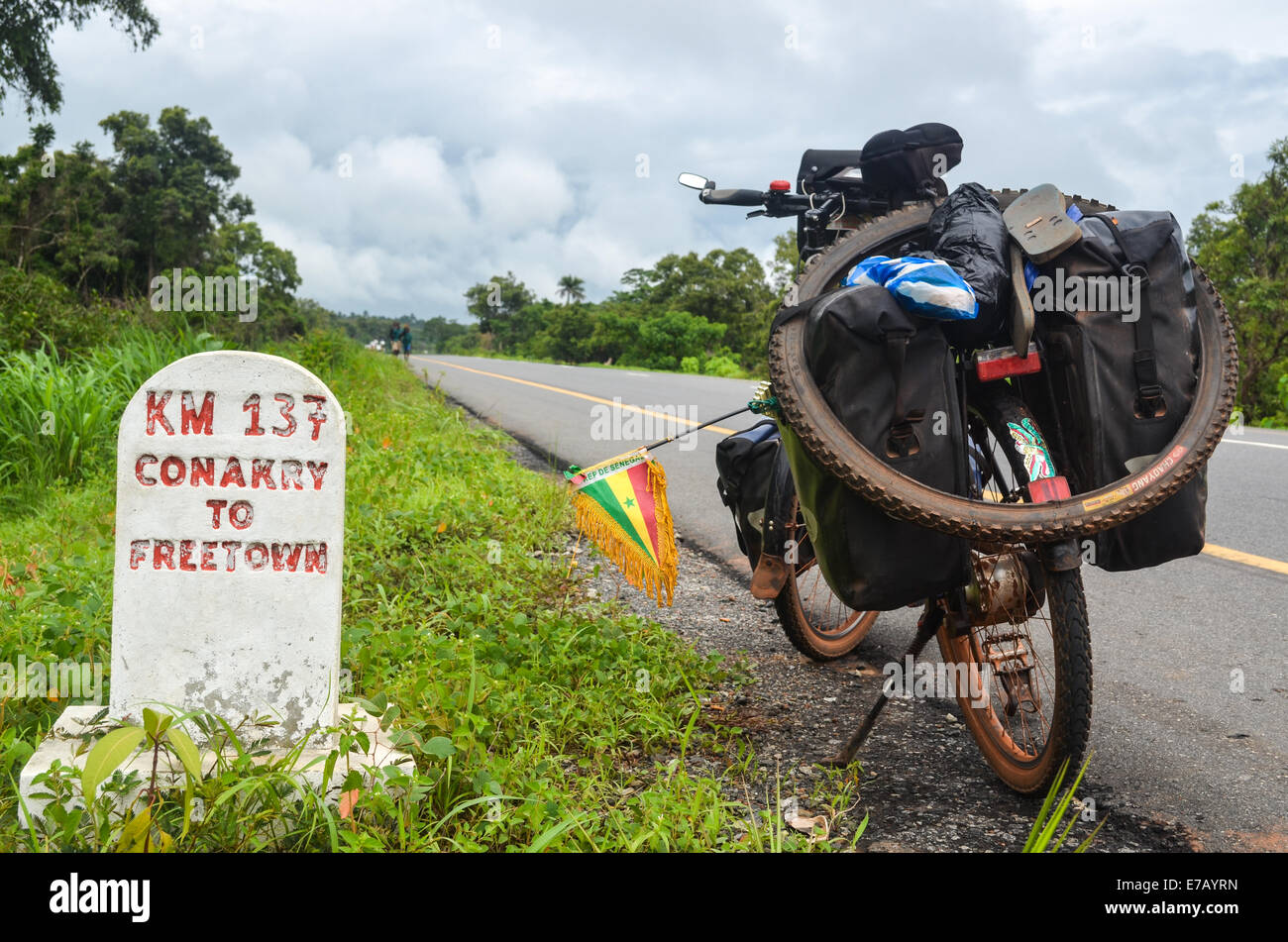 Milestone reading kilometers from Conakry to Freetown on the EU-funded newly built road in Sierra Leone - Stock Image