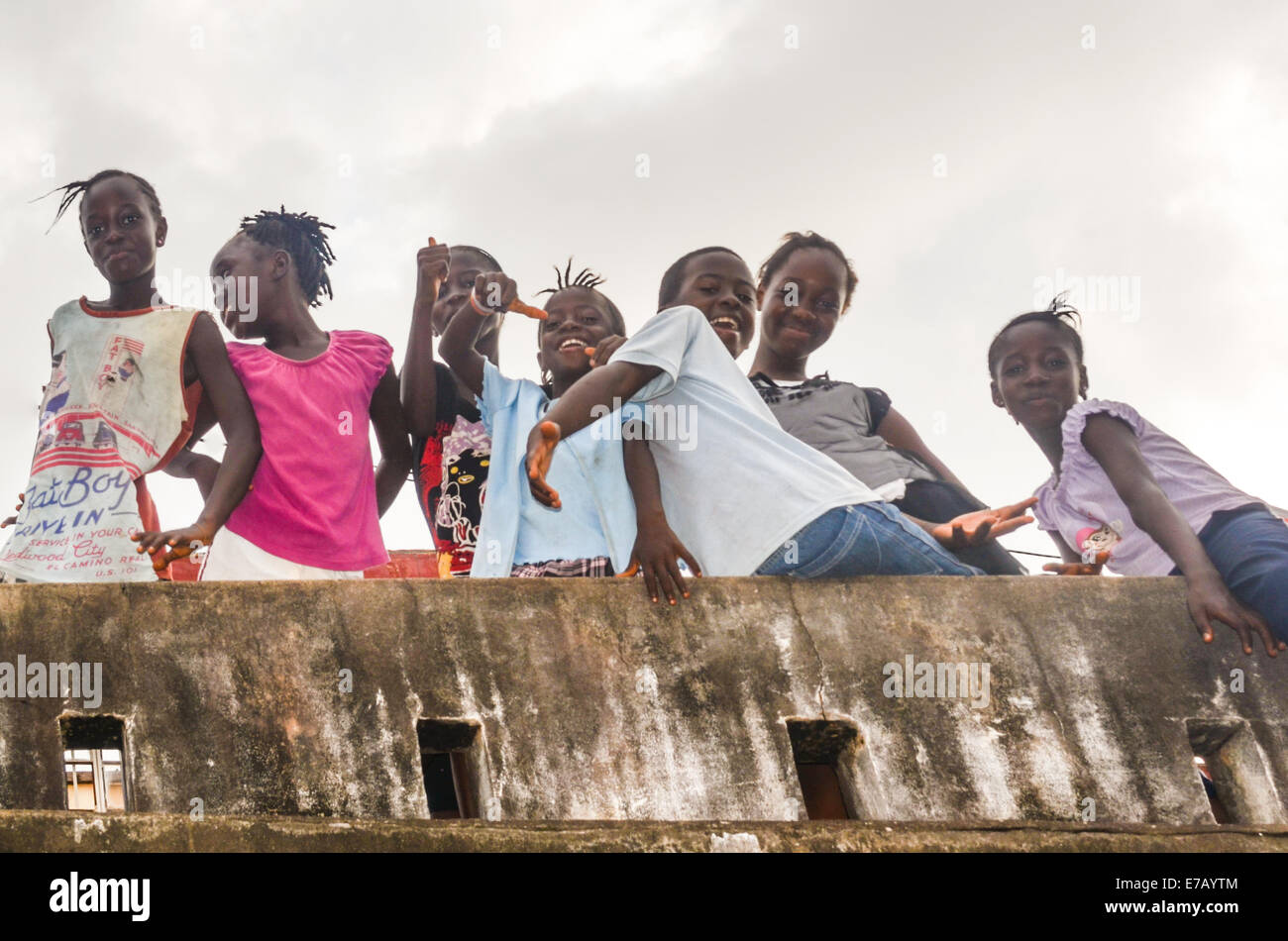 Young girls posing in the streets of Freetown, Sierra Leone, Africa - Stock Image