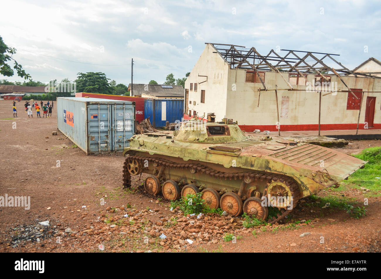 Remains of the civil war, a tank on a playground in Sierra Leone near Freetown - Stock Image