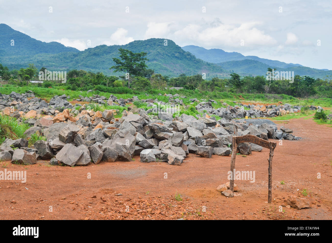 Stones to be crushed on the peninsular road near Freetown, Sierra Leone - Stock Image