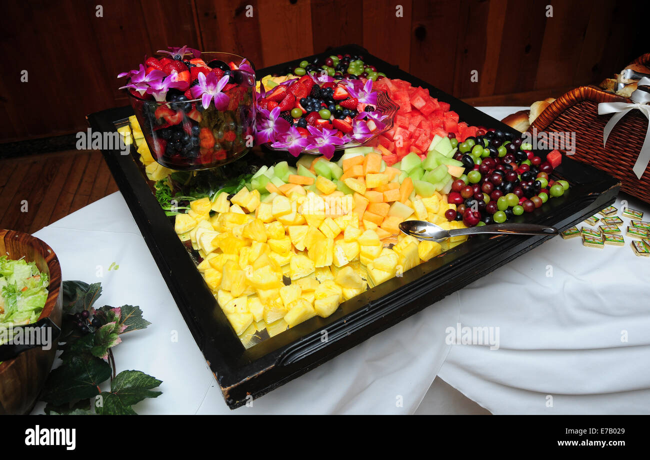A elegant platter of fruit in a buffet line. - Stock Image
