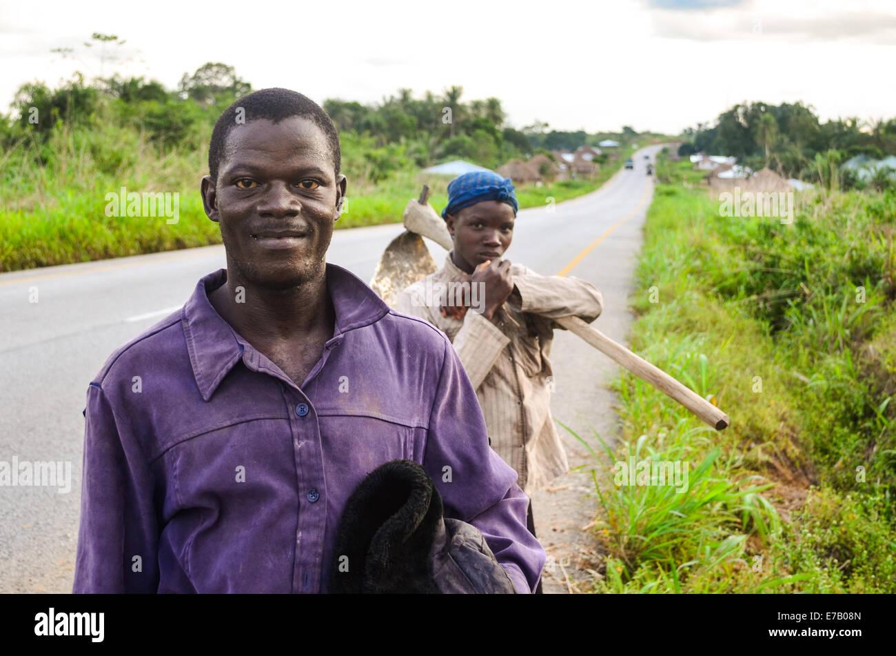 Two men after work in Sierra Leone Stock Photo