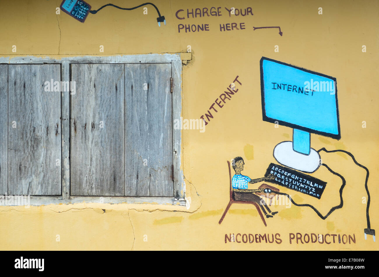 Internet café in the rural Sierra Leone, that is mostly used to charge cellphones as people don't have - Stock Image