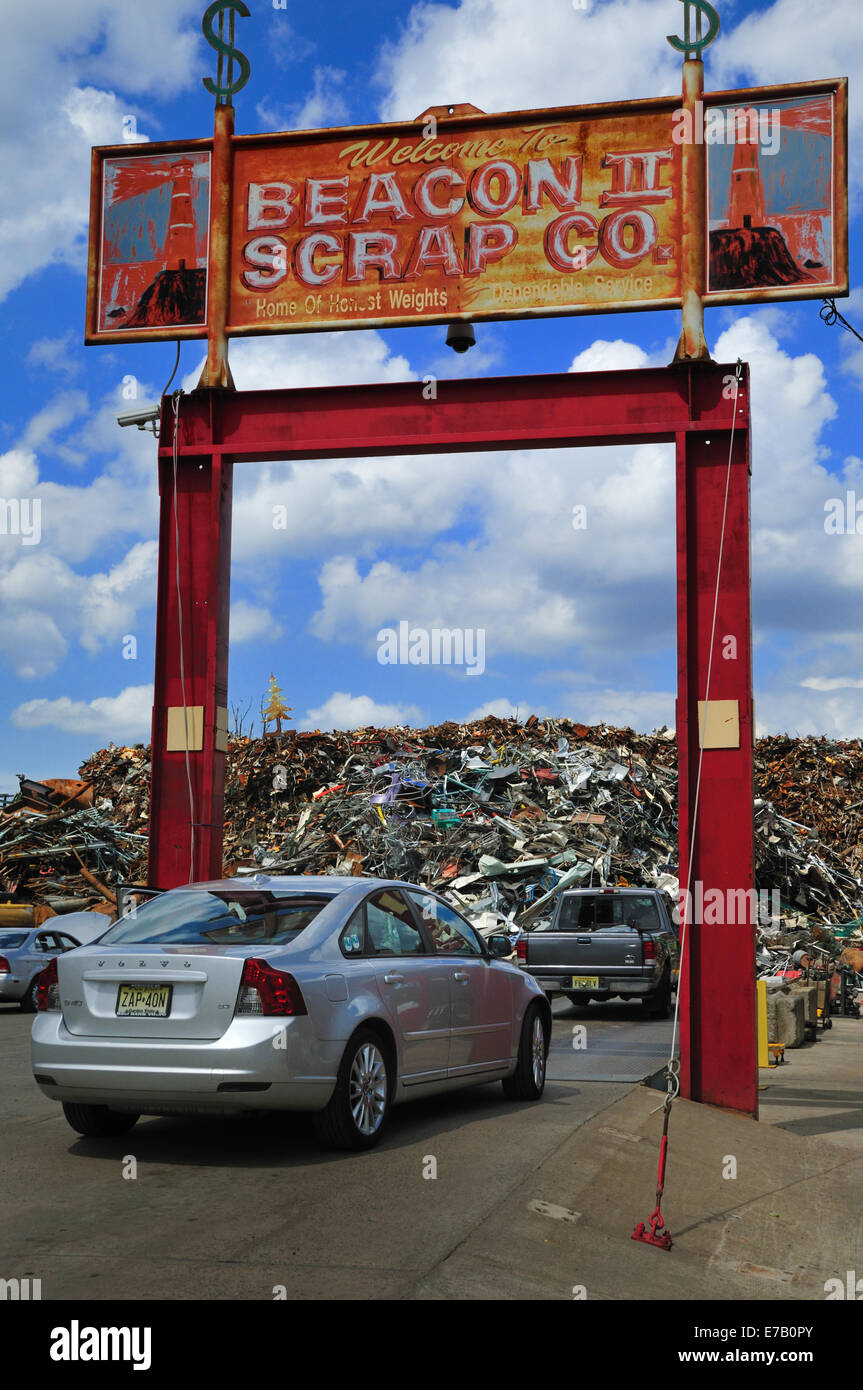 Car waiting to drive onto scale at the Beacon Scrap Co., South Amboy, New Jersey. A pile of scrap metal is in the - Stock Image