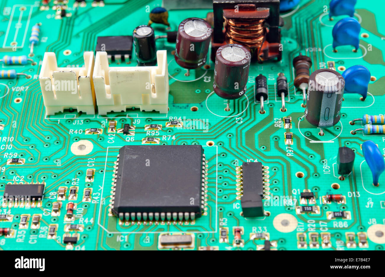 Green Electrical Circuit Board With Conductors And Transistors Stock Pictures Of