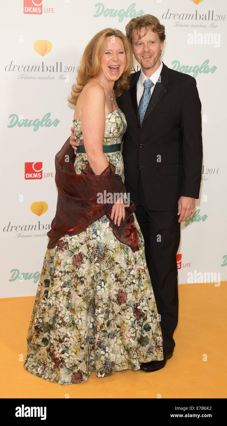 Berlin, Germany. 11th Sep, 2014. Marion Kracht and her escort arrive for  the DKMS Life Charity-Gala which runs under the motto 'look good feel  better' in ...