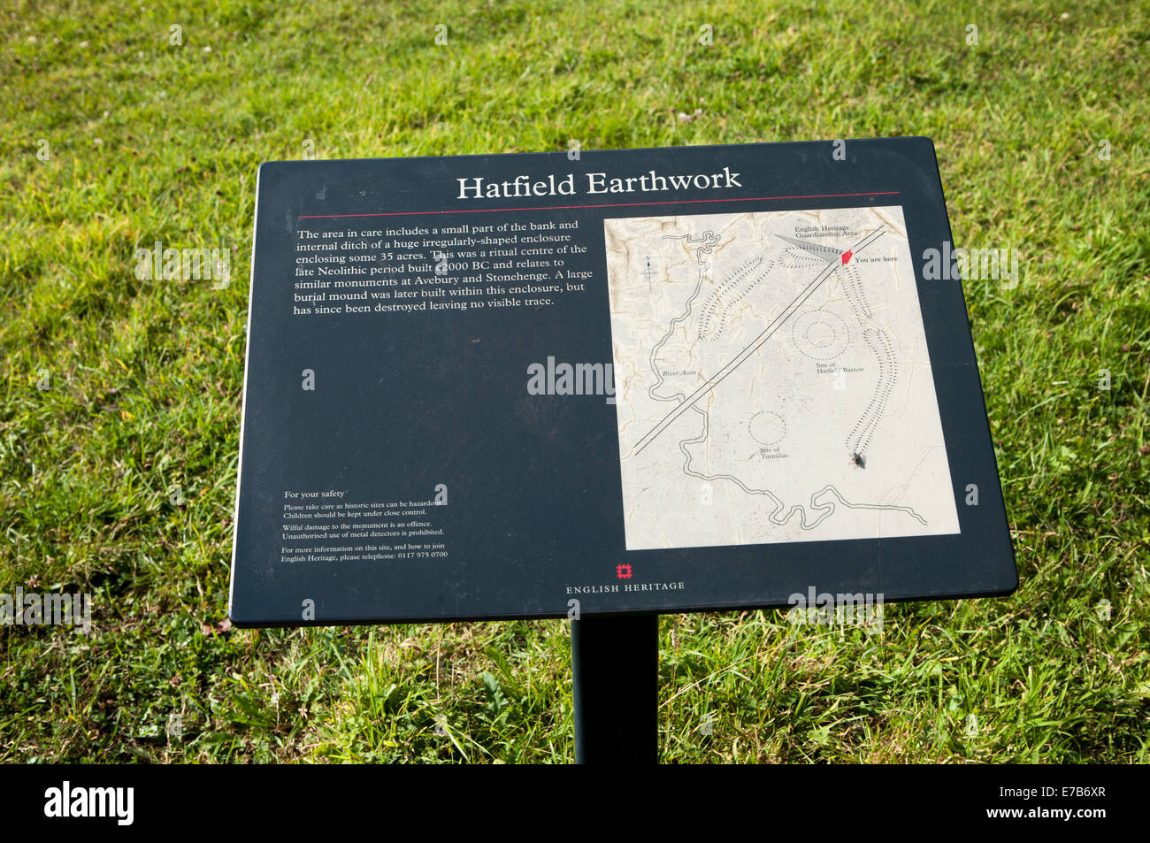 English Heritage information board for the Neolithic Hatfield earthwork site at Marden, Wiltshire, England - Stock Image