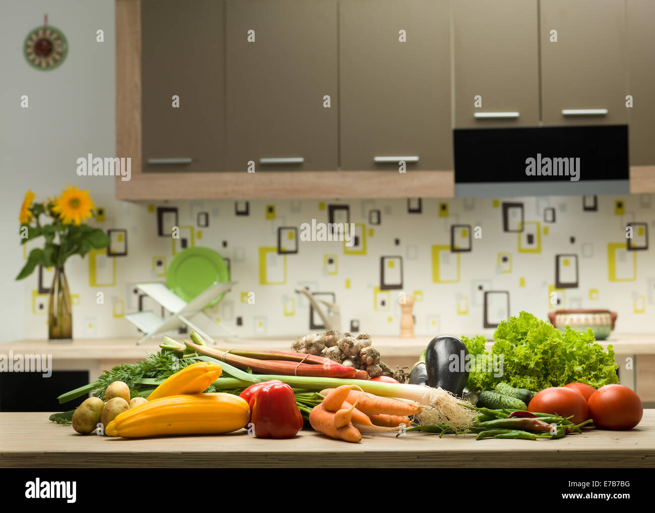 variety of healthy vegetables on a kitchen countertop - Stock Image