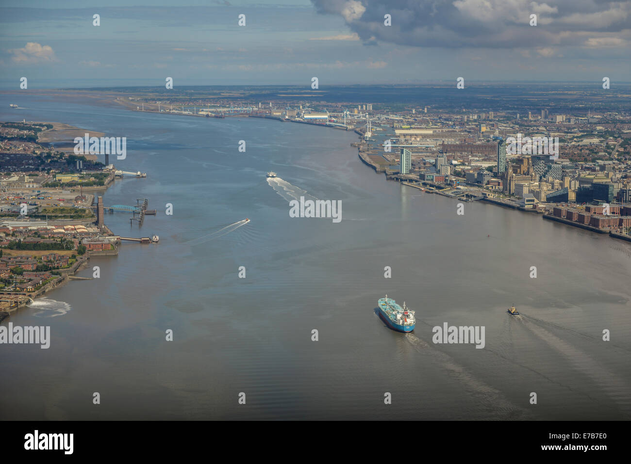 An aerial view of a bulk freighter in the River Mersey just off Birkenhead with the Irish Sea in the distance - Stock Image