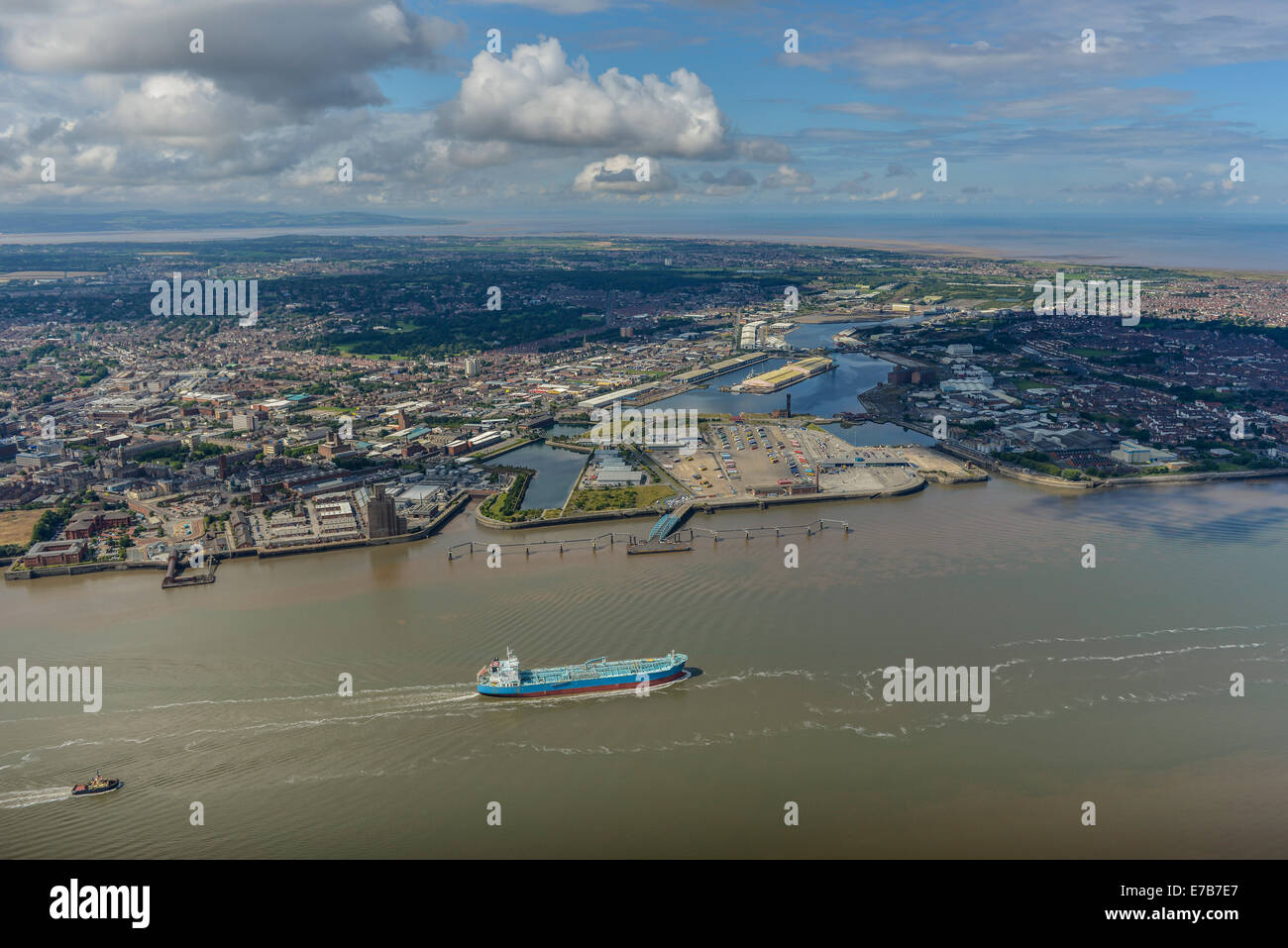 An aerial view across the Mersey showing Birkenhead and beyond that, the North Wales Coast. - Stock Image
