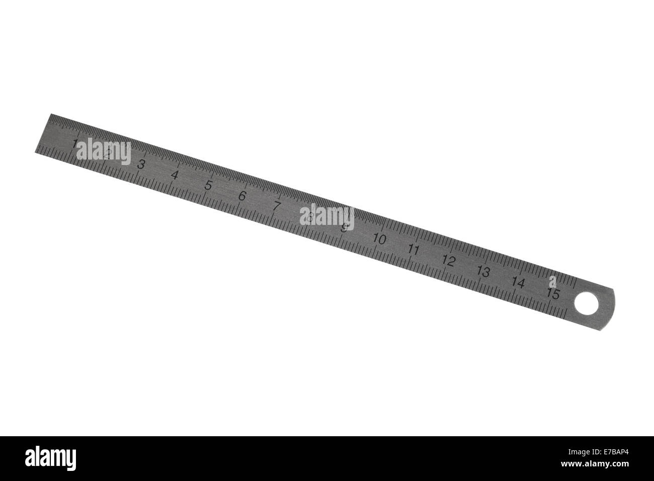 Stainless steel ruler on a white background - Stock Image