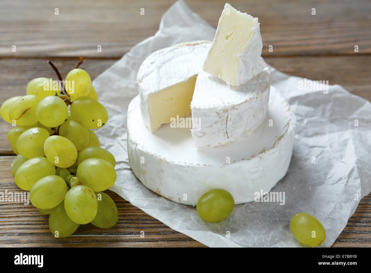 camembert  cheese with grapes, healthy food - Stock Image
