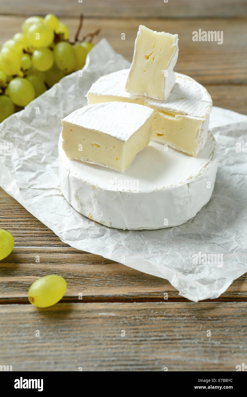 Camembert cheese cut into squares, food closeup - Stock Image