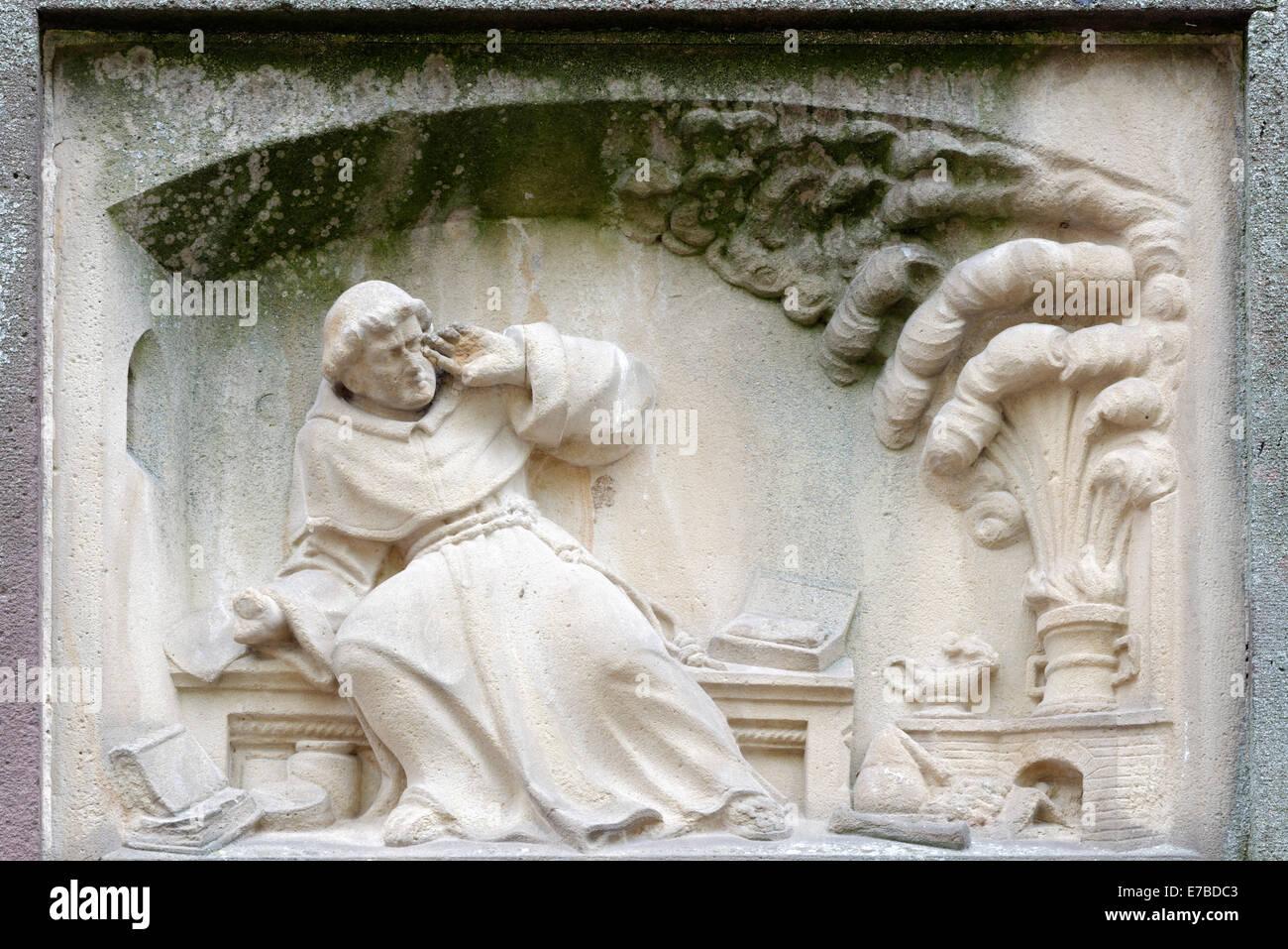 Relief of Berthold Schwarz, inventor of gunpowder, Berthold Schwarz Fountain by Josef Alois Knittel, 1855, Freiburg - Stock Image