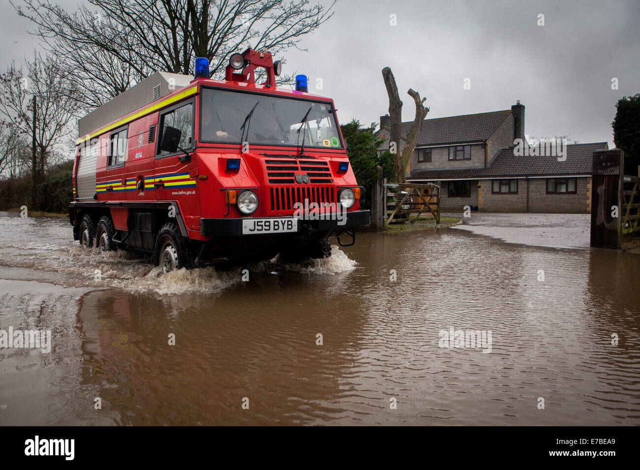 A fire service truck drives through Thorney, Somerset. Stock Photo