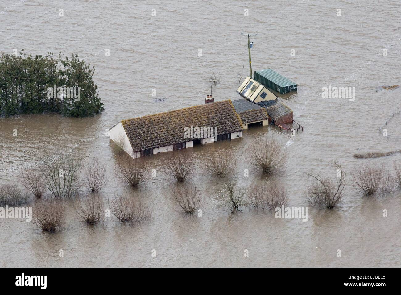A bungalow with flood water nearly up to its roof in Moorland. Where all but a handful of residents have been evacuated. - Stock Image
